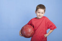 Young boy in outfit with soccer ball Stock Photography