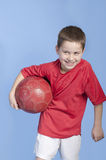 Young boy in outfit with soccer ball Royalty Free Stock Photo