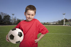 Young boy in outfit with soccer ball Stock Photos