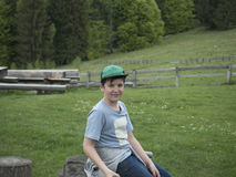 Young boy outside in the mountains Royalty Free Stock Photos