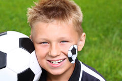 Young boy with painted face and soccer ball. Stock Photography