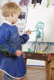 Young Boy Painting Stock Photography