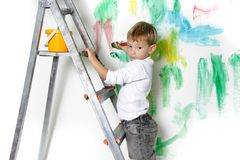Young boy painting Stock Images
