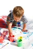Young Boy Painting Stock Image