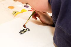 Young Boy Painting a Cat Royalty Free Stock Photo