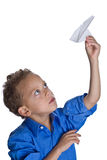 Young boy with paper plane. Young boy plays with paper plane royalty free stock photo