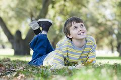 Young Boy in Park Stock Photo