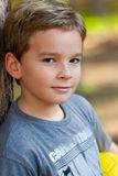 Young boy in the park with the football Stock Photo