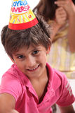 Young boy in party hat. Young boy in a birthday party hat Royalty Free Stock Image