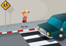 A young boy at the pedestrian lane Royalty Free Stock Image