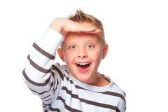 Young boy peeking Stock Image