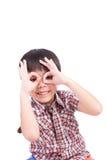 Young boy peeking through hand. On white background royalty free stock image