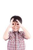 Young boy peeking through hand. On white background stock image