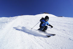 Young boy performing carved ski turn Royalty Free Stock Image