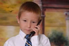 Young Boy on Phone 3 Royalty Free Stock Image