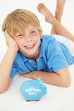 Young boy with piggy bank Royalty Free Stock Photos