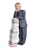 Young Boy with a Pile of Books Stock Images