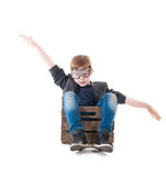 Young boy pilot flying a wood box Royalty Free Stock Photo