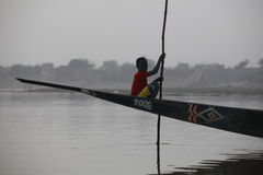 Young boy in a pirogue Royalty Free Stock Photography