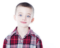 Young boy in plaid shirt. On white Royalty Free Stock Photos