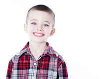 Young boy in plaid shirt. On white Royalty Free Stock Images