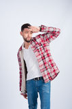 Young boy in plaid shirt looks into the distance Royalty Free Stock Images