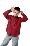 Young boy in plaid shirt making a face Royalty Free Stock Photography