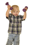 Young boy plaid shirt weights up Stock Image