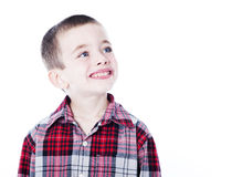 Young boy in plaid shirt  on white. While looking to the side Stock Image