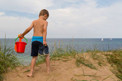 Young boy with plastic bucket Royalty Free Stock Image