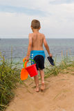Young boy with plastic bucket Stock Photos