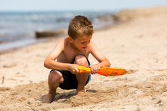 Young boy with plastic shovel Royalty Free Stock Image