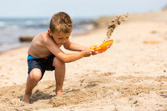 Young boy with plastic shovel Stock Images