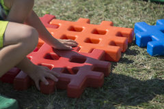 Young boy play with bricks in the garden Stock Photography