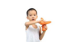 Young boy play with carrot Royalty Free Stock Photography