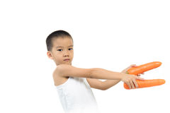 Young boy play with carrot Stock Photos