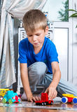 Young boy play with cars Royalty Free Stock Image
