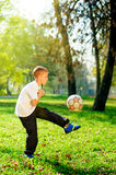 Young boy play football Royalty Free Stock Photography