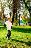 Young boy play football Stock Image
