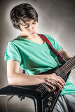 Young boy play a guitar Stock Images
