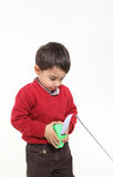 Young boy play with meter. Isolated on white young boy play with meter Stock Image
