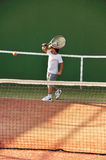 Young boy play tennis Stock Photos