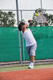 Young boy play tennis Stock Photo