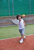 Young boy play tennis Stock Images