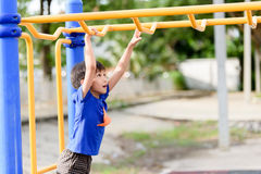 Young boy play with yellow bar Stock Photo