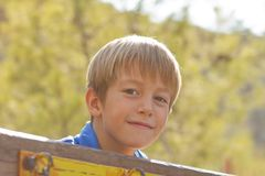 Young boy on the playground Stock Images
