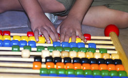 Young Boy Playing Abacus Stock Image