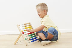 Young boy playing with abacus Stock Photography