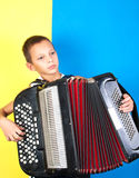 Young boy playing a  accordion Stock Photo
