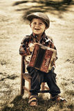 Young boy playing accordion Stock Photography